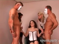 Hot minx in sexy corset giving two guys handjobs
