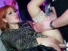 Beautiful clothed women in a club orgy