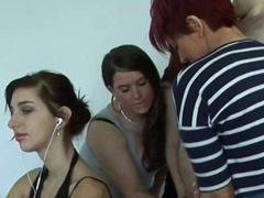 Femdom group tugging subject cock for his cum