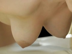 Buxom babe stacie jaxxx pinches and palms her big bouncing tits and then leans forward to satisfy her bald ...