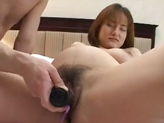 Big black toy slides into pregnant japanese pussy