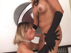 Shemale and girl in black gloves fool around
