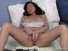 Young looking milfplays with pussy