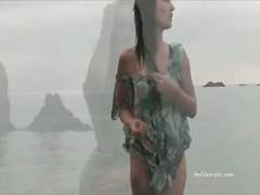 Girl in a sexy short dress walks the beach