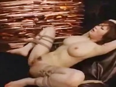 Busty girl bondaged to chair fingered fucked with strapon and doubledildo by mistress in the dungeon