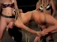 Girl hanging in bondage getting her nipples tortured whipped licking pussy fucked with electric dildo in the basement
