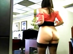Girl undressing behind her boss