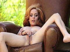 Gorgeous redhead chick ashley graham entertains herself by finger-fucking