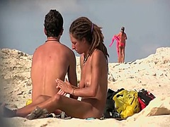 Beach voyeur man admires topless chicks